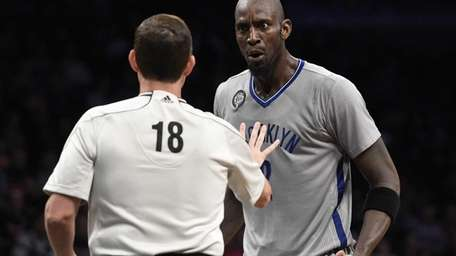 Brooklyn Nets forward Kevin Garnett reacts to a