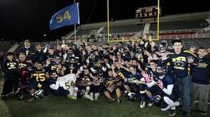 "The Shoreham football team holds up ""54"" with"