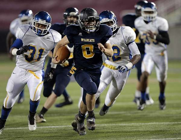 Shoreham-Wading River's Chris Rosati outruns the Roosevelt defense