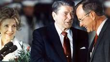 President Ronald Reagan shakes hands with Vice President