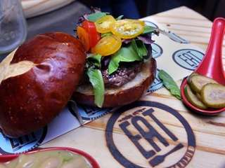 A gastro burger is served with house-made pickles