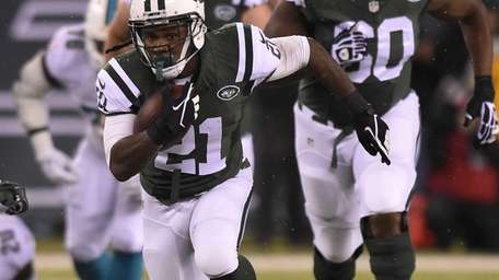 New York Jets running back Chris Johnson runs