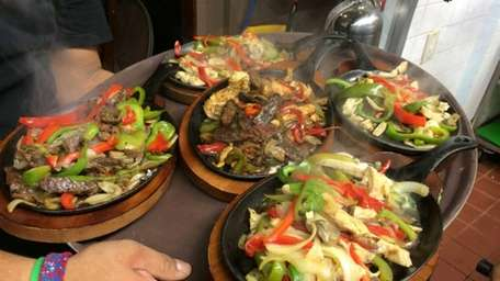 Sizzling fajitas at the new Cancun Mexican Restaurant