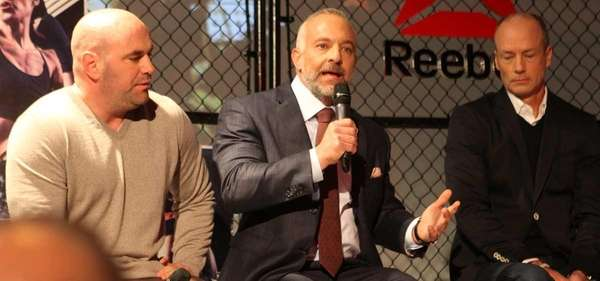 UFC chairman Lorenzo Fertitta, center, announces the UFC's