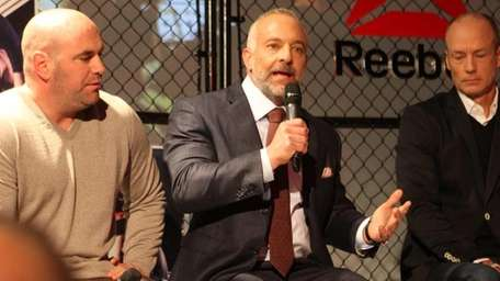 UFC chairman Lorenzo Fertitta, center, announces the UFC's