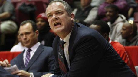 Stony Brook head coach Steve Pikiell talks to