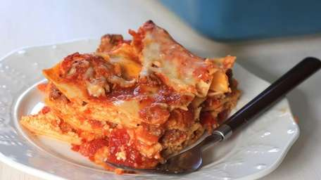 Pre-boiled or no-cook lasagna noodles, prepared tomato sauce,