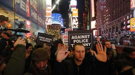 Protesters march through Manhattan on Wednesday, Dec. 3,