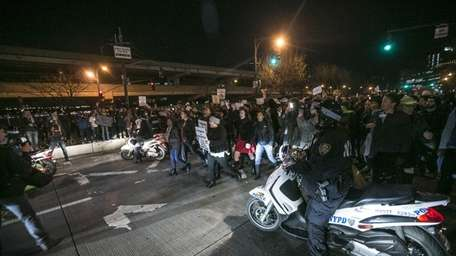 Protesters march on the West Side Highway after