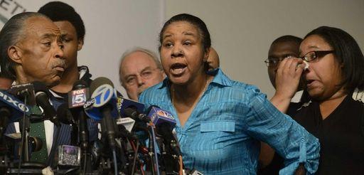 Esaw Garner, widow of Eric Garner, is surrounded