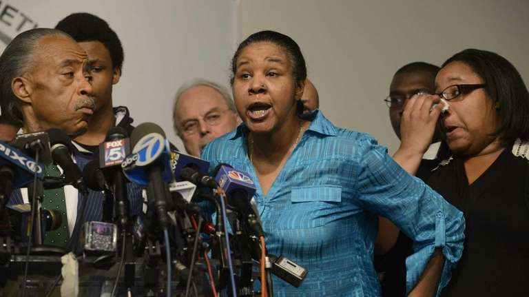 Esaw Garner, widow of Eric Garner, is surrounded