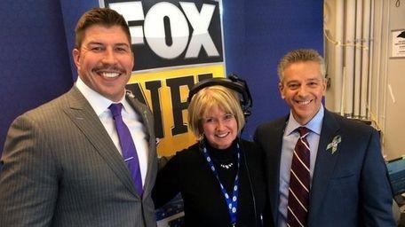 FOX NFL broadcaster David Diehl, left, shows off