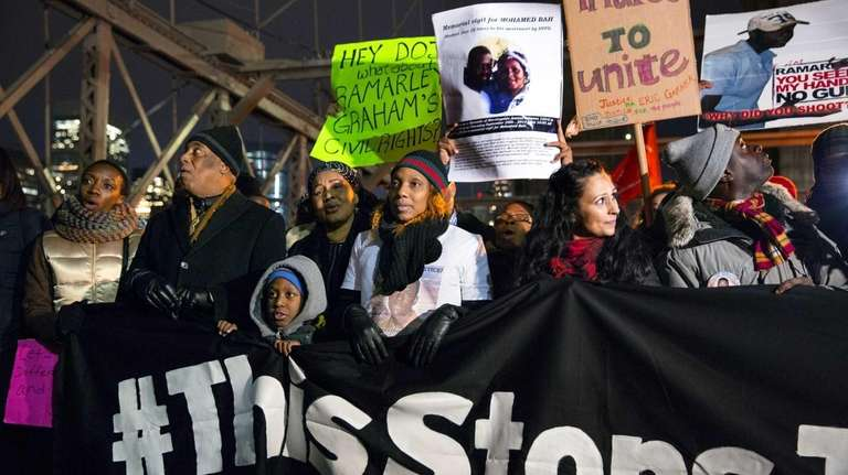 Protestors react on Thursday, Dec. 4, 2014 to