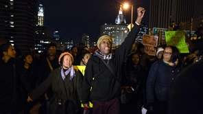 Protesters march over the Brooklyn Bridge on Thursday,