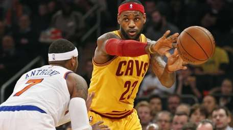 Cleveland Cavaliers forward LeBron James (23) passes around