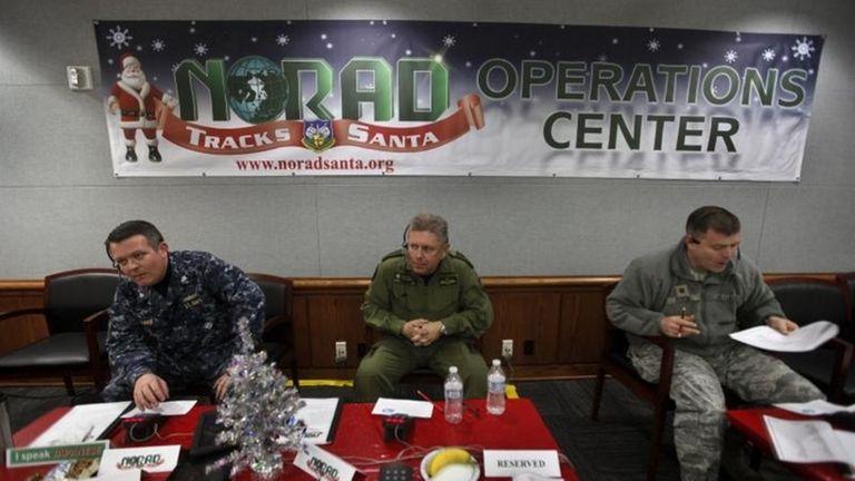 NORAD Deputy Commander Lt. General Alain Parent, center,