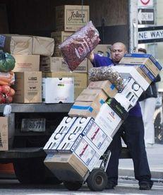 A worker unloads grocery goods in Washington, D.C.,