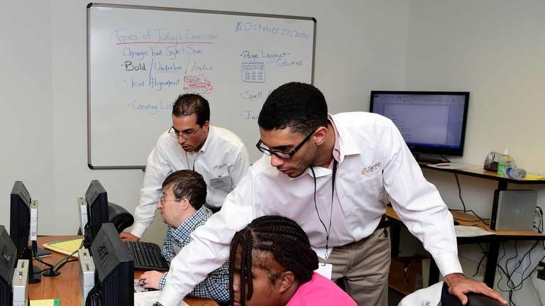 eVero class instructors Joseph Malebranche and Ronald Torres,