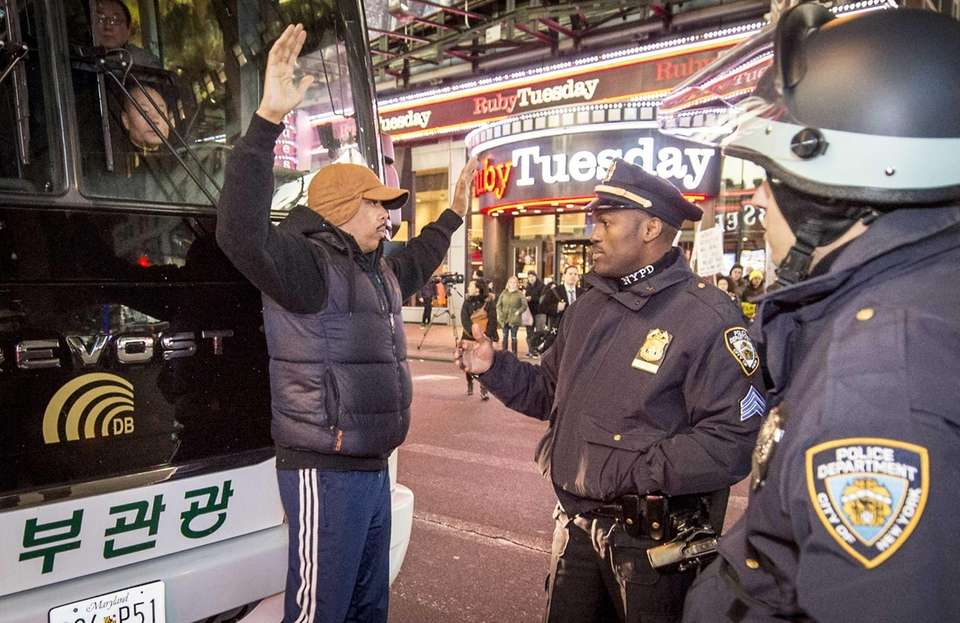 New York City police approach Marvin Day, of