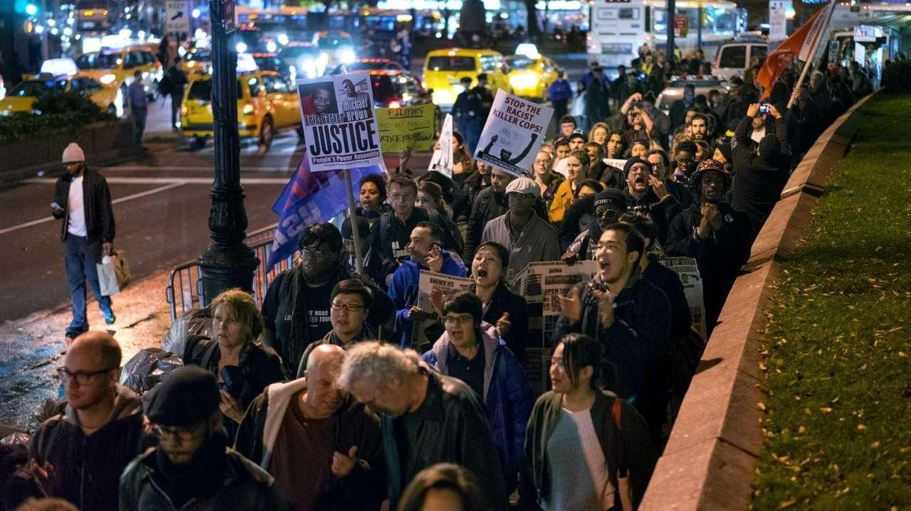 People gather at Union Square in Manhattan Monday,