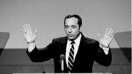 New York Gov. Mario Cuomo gestures while delivering