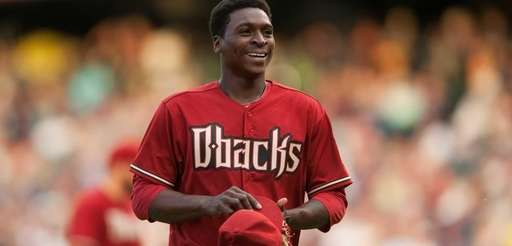 Didi Gregorius of the Arizona Diamondbacks laughs between
