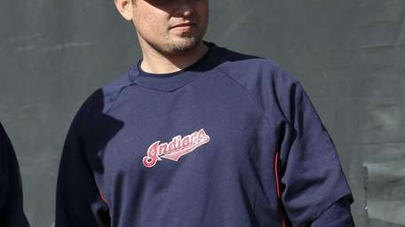 Cleveland Indians bullpen coach Kevin Cash watches during