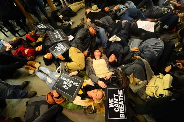 Protesters rallying against a grand jury's decision not