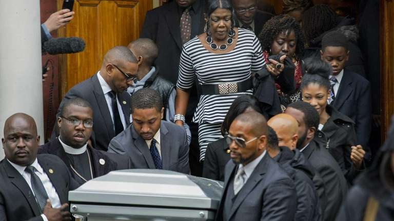 The coffin holding Akai Gurley, the Brooklyn man