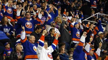 New York Islanders fans cheer after a second
