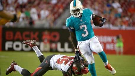 Miami Dolphins running back Orleans Darkwa rushes past