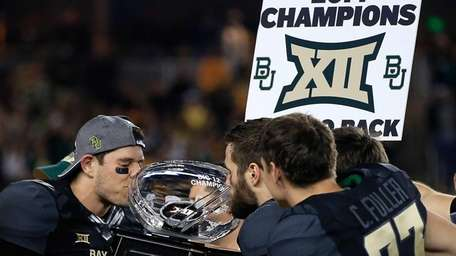 Bryce Petty of the Baylor Bears kisses the