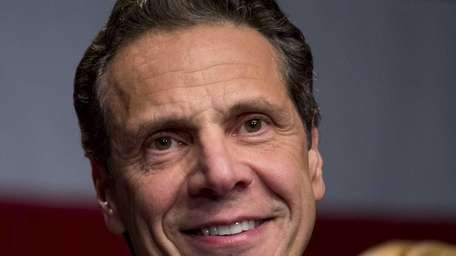 Gov. Andrew Cuomo speaks as supporters gather in