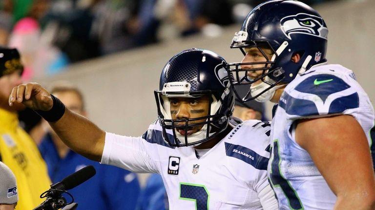 Seattle Seahawks quarterback Russell Wilson celebrates his 26-yard