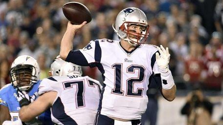 New England Patriots quarterback Tom Brady throws a