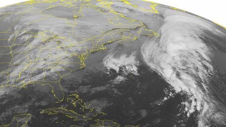 This NOAA satellite image taken Monday, Dec. 8,