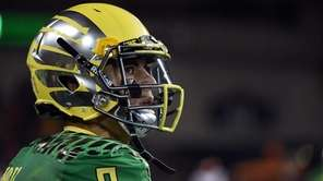 Oregon quarterback Marcus Mariota looks out from the