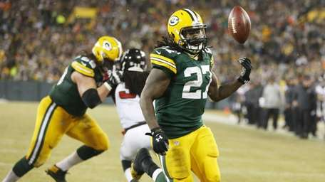 Green Bay Packers' Eddie Lacy celebrates his touchdown
