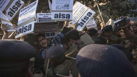 Police push away protestors from All India Students