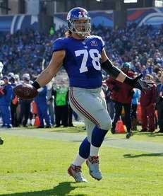 Markus Kuhn of the New York Giants carries