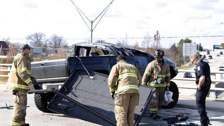 Emergency personnel tend to a damaged truck driven