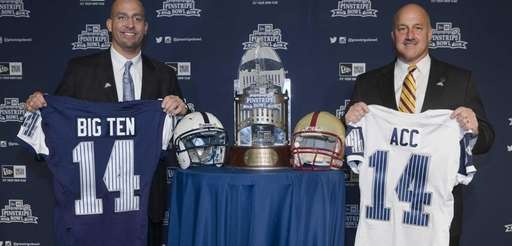 Penn State Football head coach James Franklin, left,