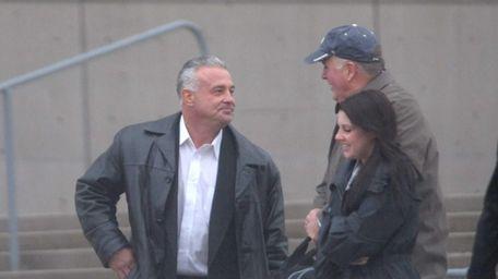 Former Suffolk correction officer Steven Compitello, left, leaves