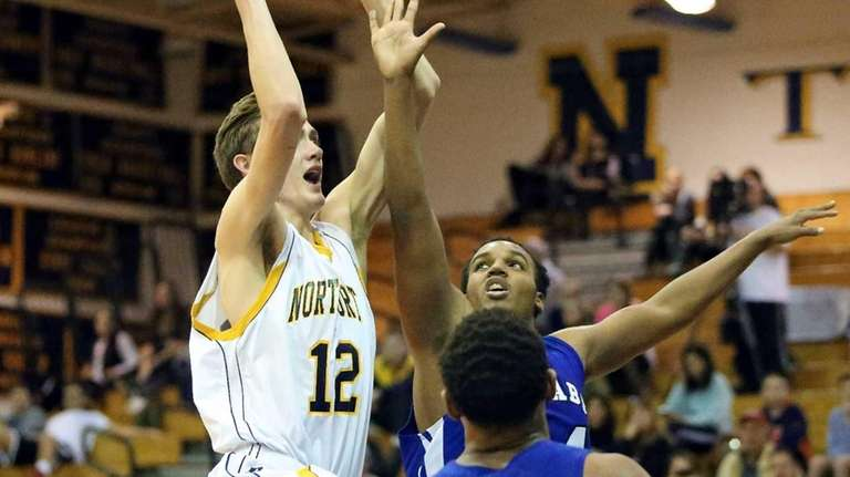 Northport forward Lukas Jarrett goes up for the