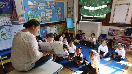 Four-year-old students in a state-funded pre-K program participate