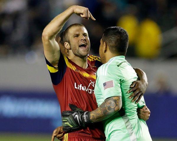 Real Salt Lake defender Chris Wingert, left, embraces