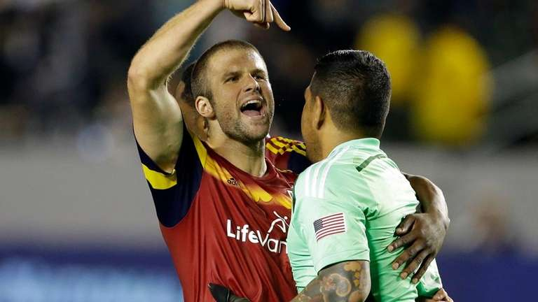 Real Salt Lake defender Chris Wingert, left, embraces