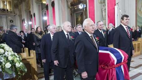 Pallbearers and former teammates from left, Dickie Moore,