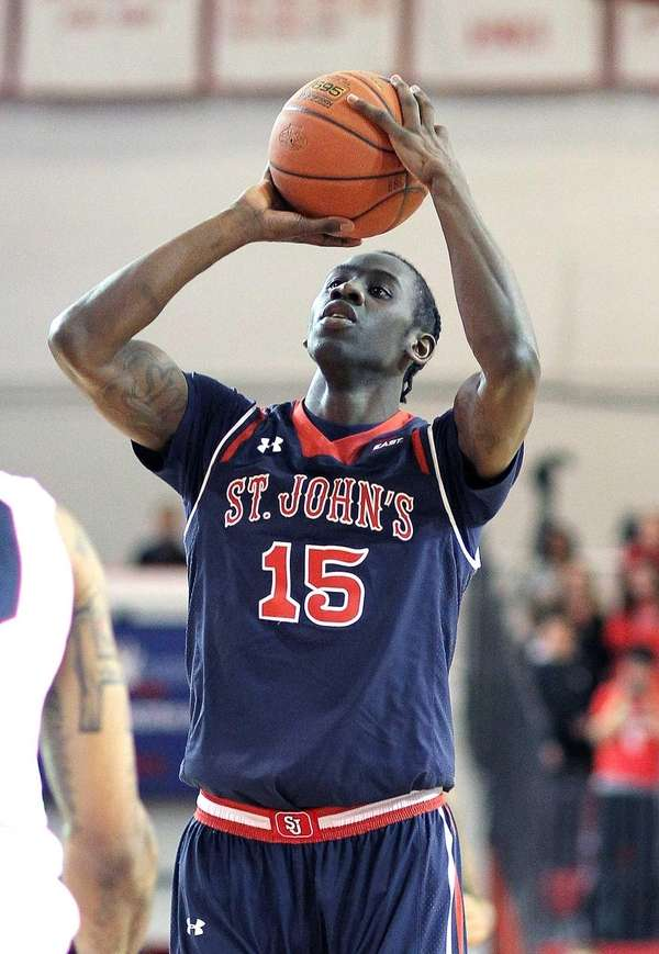 St John's Sir'Dominic Pointer shoots during a non-conference