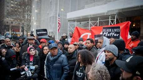 Russell Simmons speaks as activists call on New